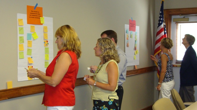 New Hampshire QI 101 participants working together during a QI method simulation.